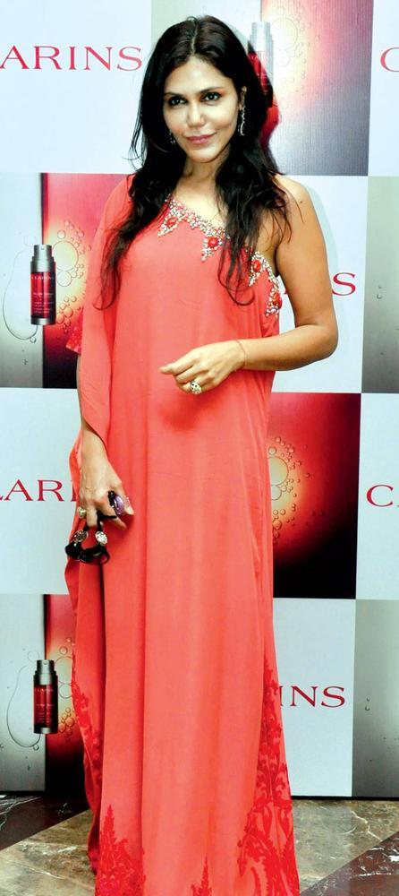 Nisha Jamvwal Makes A Style Statement In A Full Length Gown At The Launch Of Clarins Double Serum