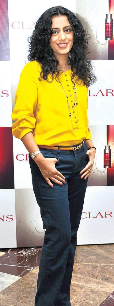 Parveen Dusanj Strikes A Pose At The Launch Of Clarins Double Serum