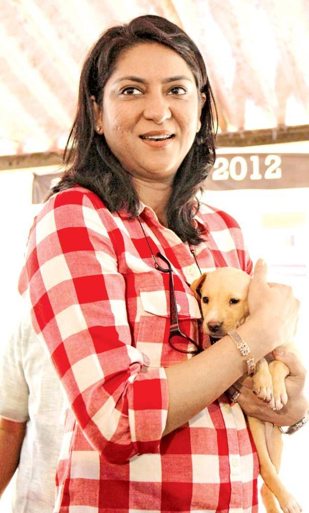 Priya Dutt Snuggles Up To A Pooch In A Puppy Love Event