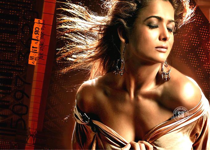 Amrita Arora Hot Expression In Flowing Hair Photo