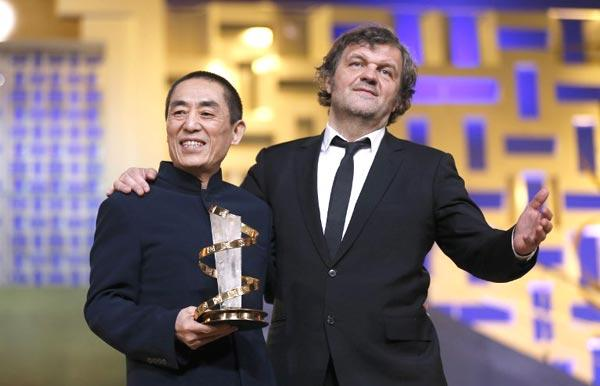 Chinese Director Zhang Poses With Serbian Film Director Emir At 12th Marrakech International Film Festival