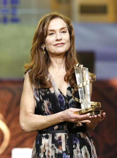 French Actress Isabelle Holds Her Tribute Award During The 12th Marrakech International Film Festival