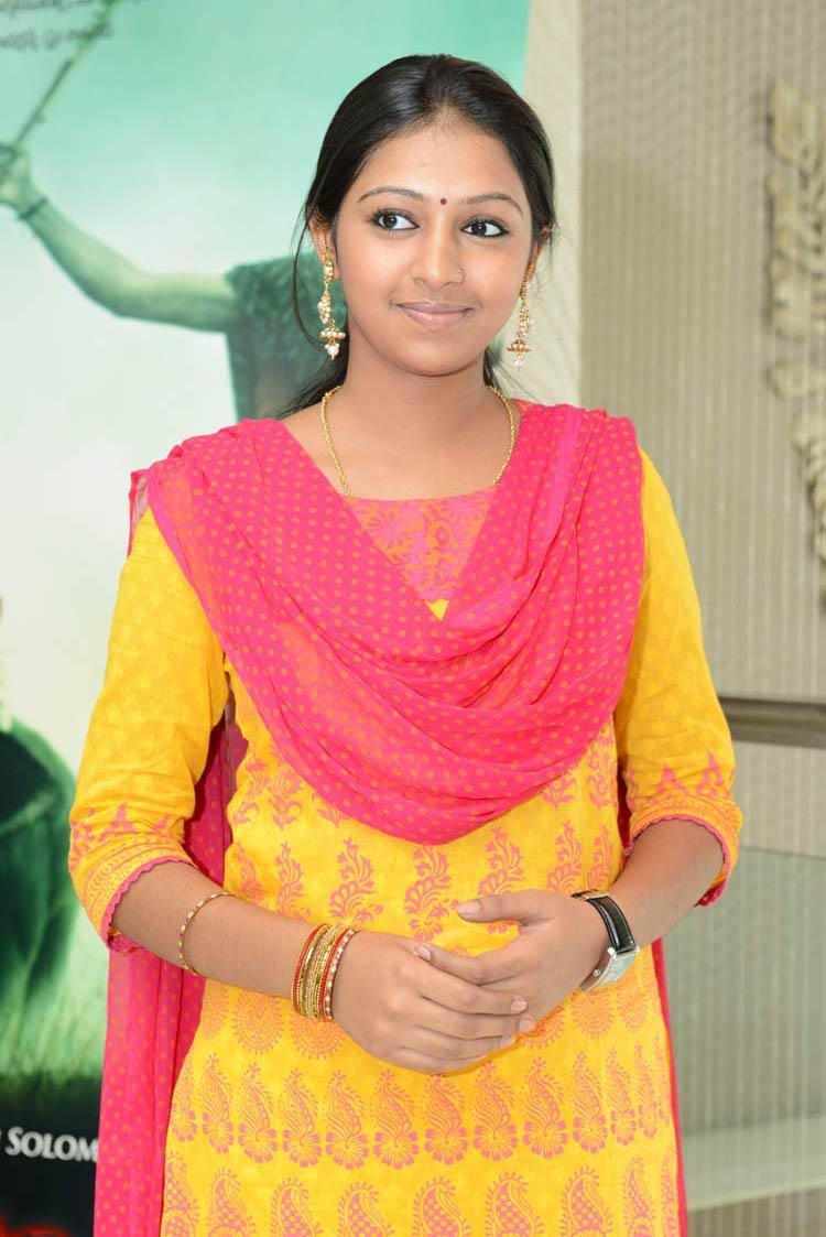 Lakshmi Menon Cute Look Photo Still In A Yellow Chudidar At Gajaraju Press Meet