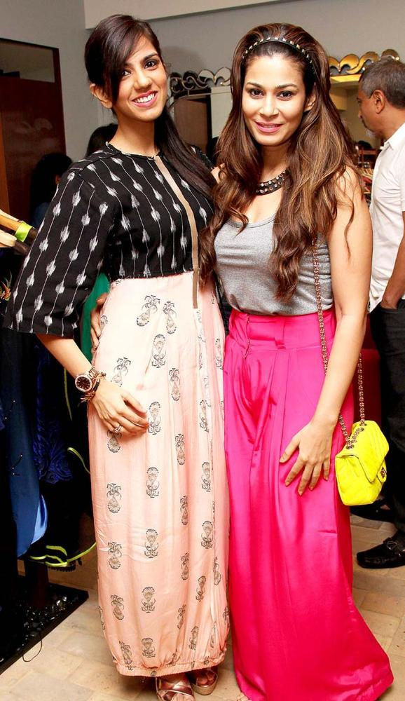 Nishka With A Friend Smiling Pose At Aanchal Kumars New Collection Launch