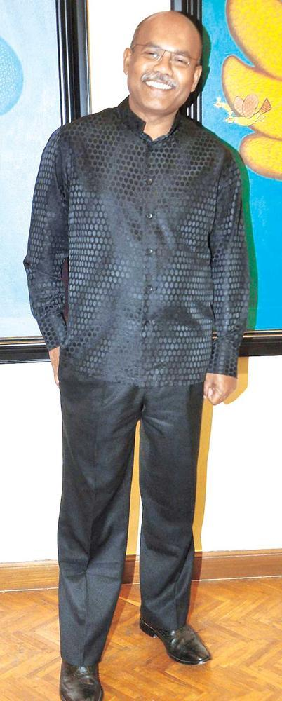 Ajay De Is Seen Without His Trademark Hat At An Art Evening In SoBo