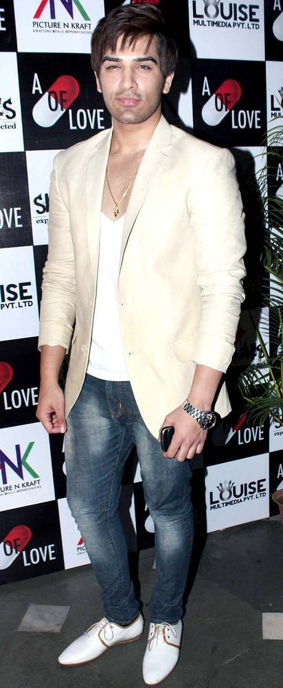Paras Chhabra Pose For Camera At The Launch Of Sara Khan Production House