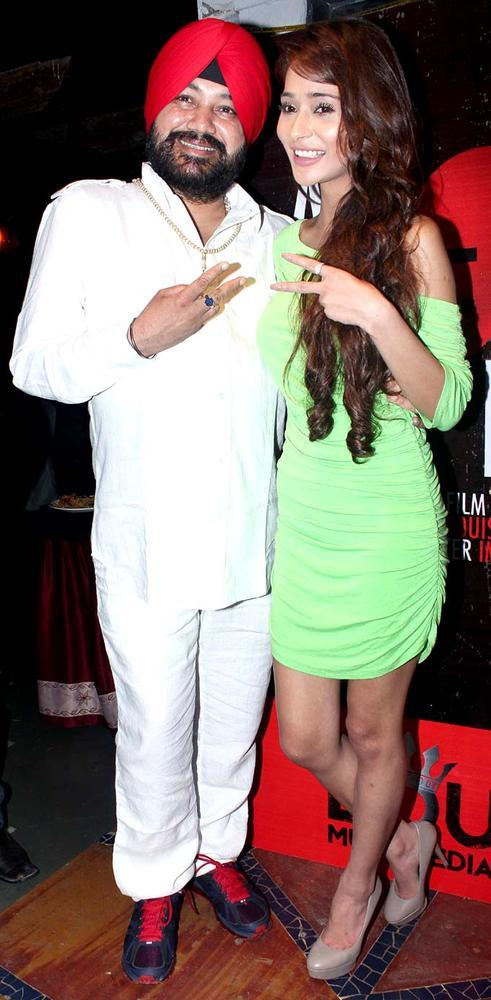 Sara Khan With Daler Mehendi Posed During At The Launch Of Her Production House