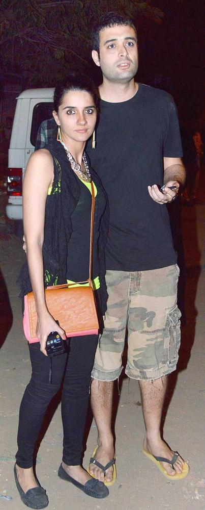 Shruti Seth With Hubby Danish Aslam Pose For Camera At Guns N Roses Concert