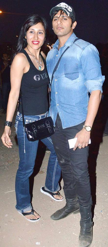 Teejay Sidhu With Hubby Karanvir Bohra Posed During At Guns N Roses Concert