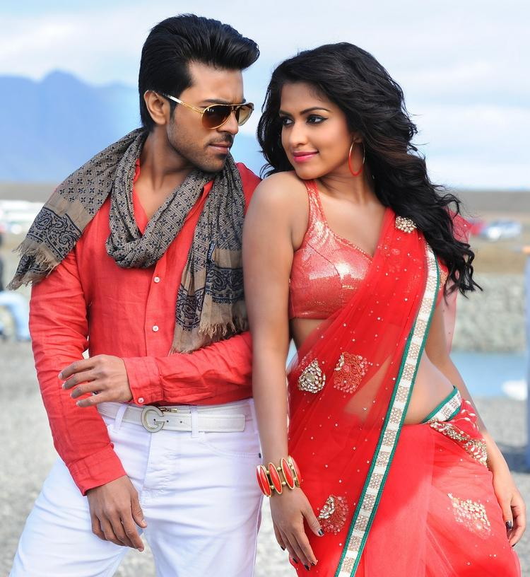 Ram Charan And Amala Hot Look Still From Nayak Movie