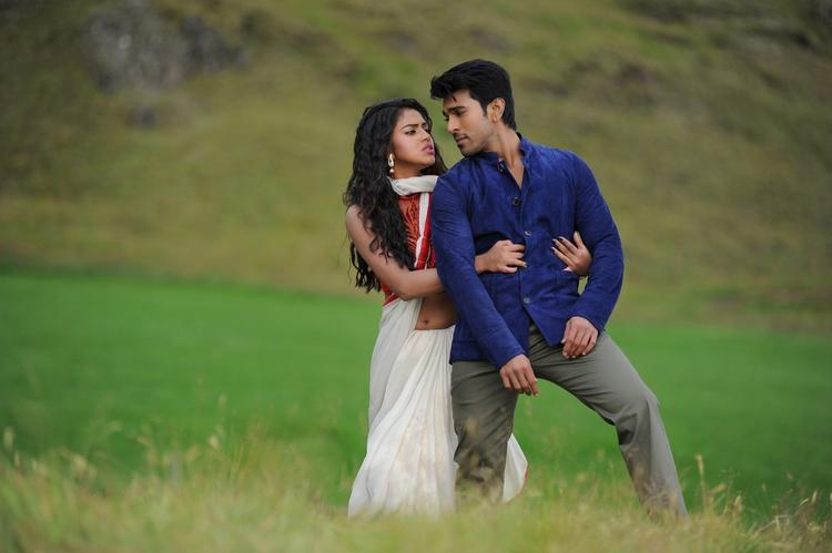 Ram Charan And Amala A Still From Nayak Movie