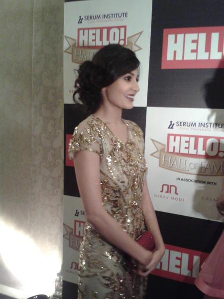 Anushka Spotted In A Golden Dress At  Hello! Magazine Event