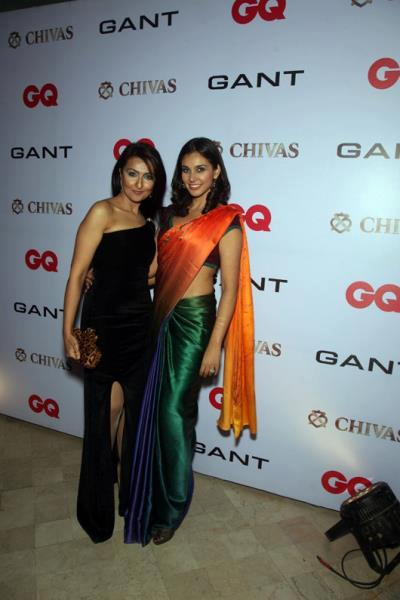Lisa Roy With Afriend Pose For Camera At GQ Best Dressed Men 2012 Party