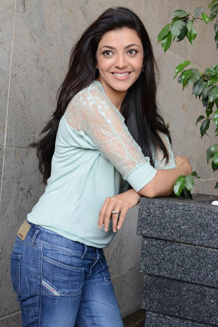 Kajal Agarwal Dazzling Look Photo Shoot In Jeans With Sky Top