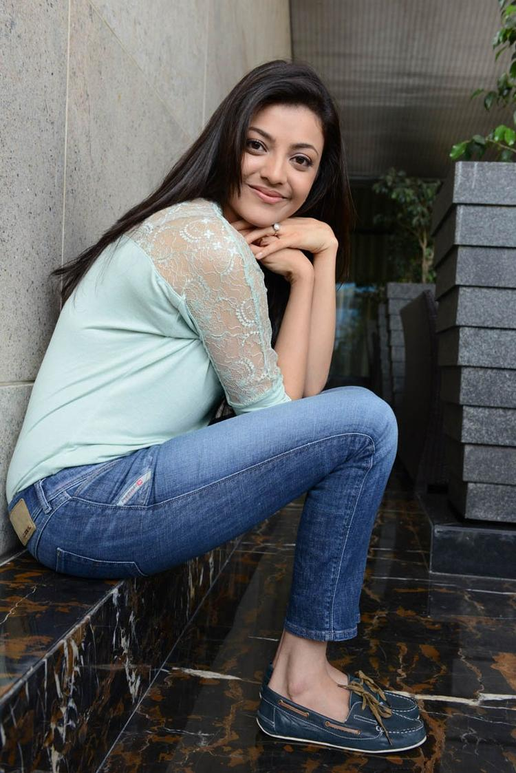 Kajal Agarwal Glamorous Look Photo Shoot In Jeans With Sky Top