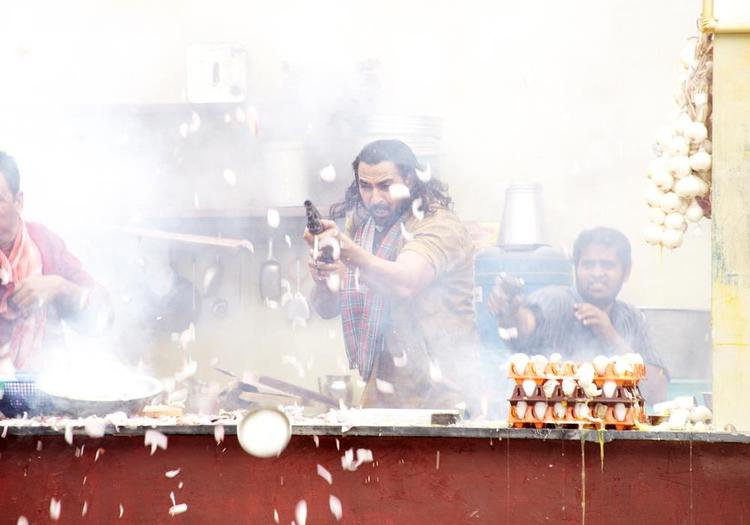 A Fight Scene Photo With Guns In Movie Dabangg 2