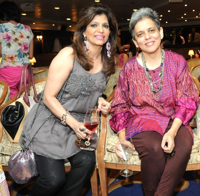 Bina Aziz And Brinda Miller Pose For The Shutterbugs With Red Wine On The Ship