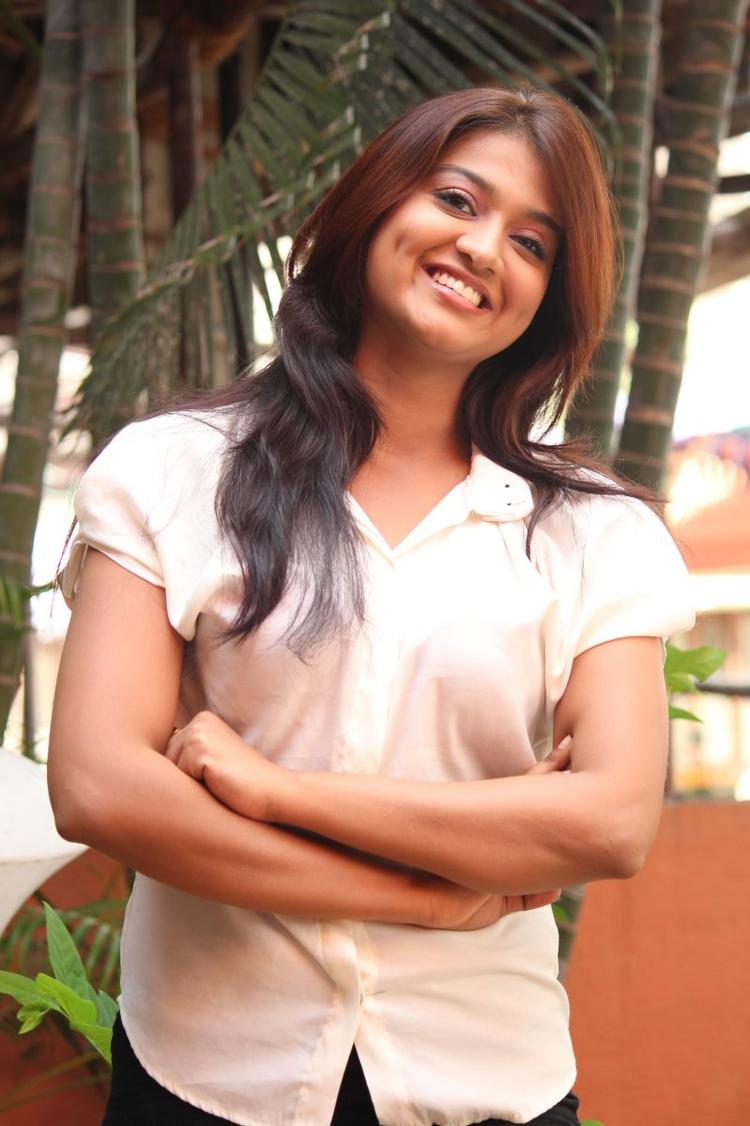Varsha Smiling Look Beautiful Photo Still