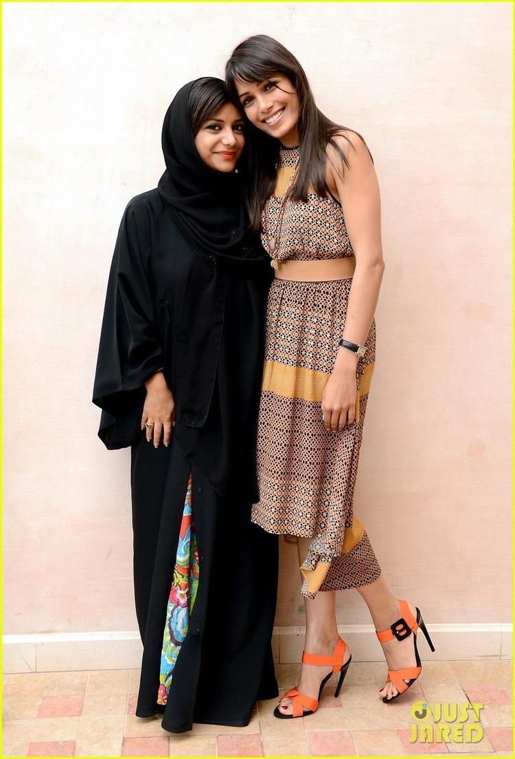 Freida Pinto With Film Maker Nayla Al Khaja Psed For Camera At Dubai Film Festival Portrait Session