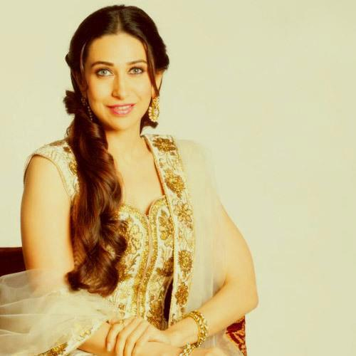 Karisma Radiant And Beautiful Look In A White Golden Dress Shhot  For Neeru Emporio Wedding Collection