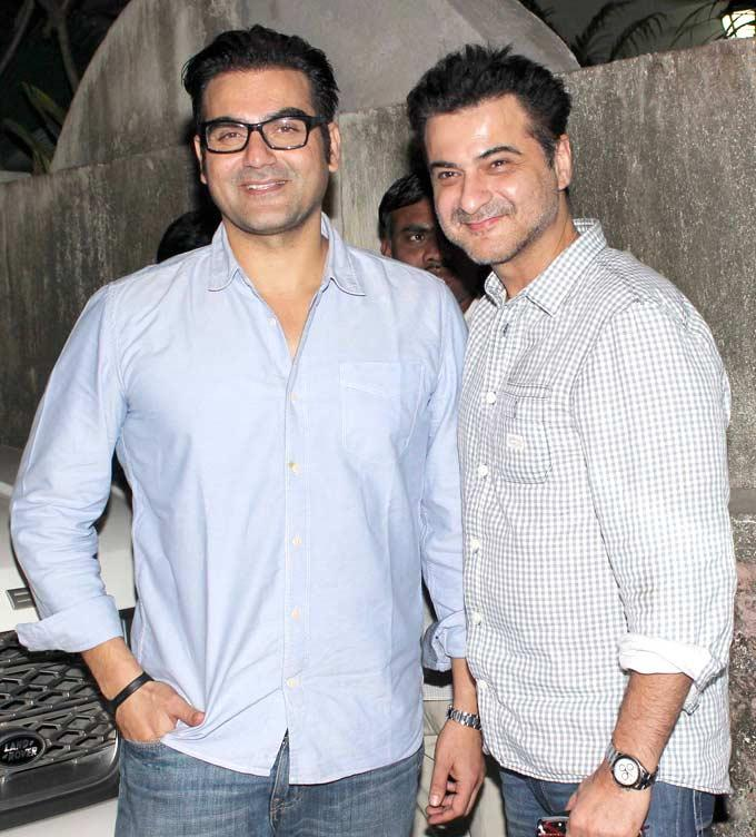 Arbaaz Khan And Sanjay Kapoor Strikes A Pose At Dabangg 2 Screening Event