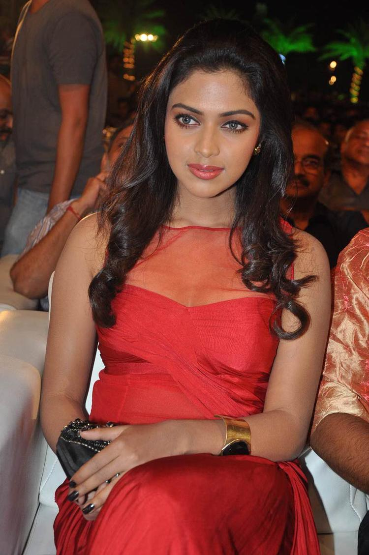 Amala Paul Looked Marvelous  In Red Long Sleeveless Dress At Naayak Audio Release Function
