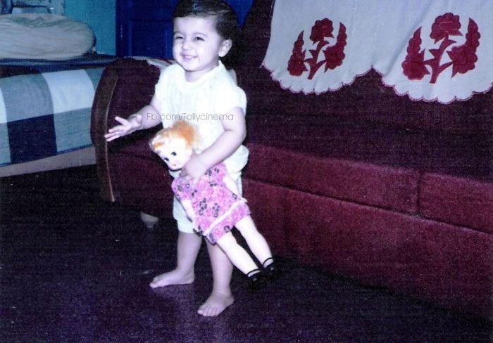 Taapsee Playing With Doll Photo In Childhood