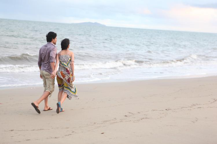 Tena And Rajeev Walking On Beach Still From Movie Table No. 21