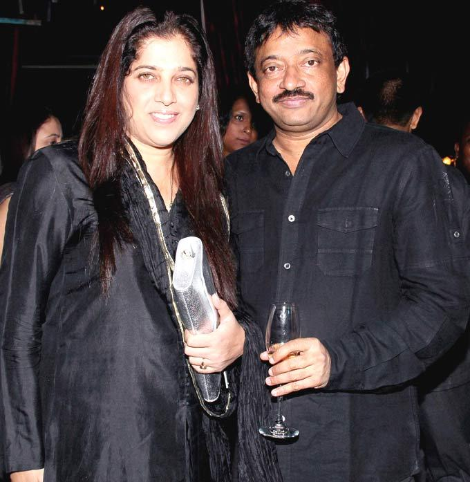 Ram Gopal Varma Posed For Camera At The Playboy Bash