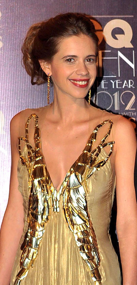 Kalki Koechlin Cute Smiling Cleavage Show Photo In A Golden Dress