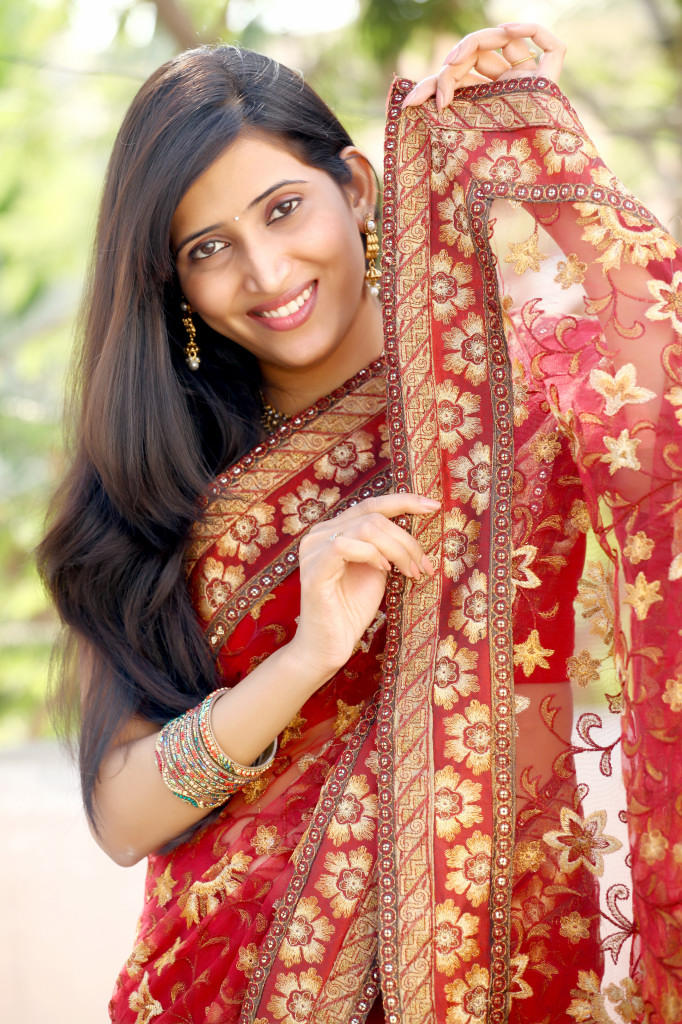 Riya Chakravarthi Dazzles In Red Saree Still