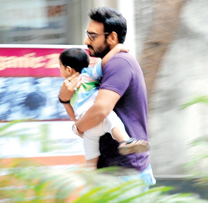 Ajay Devgan With His Son Yug Attempts To Evade The Photographers