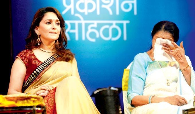 Madhuri Dixit And Asha Bhosle At The First Death Anniversary Of Photographer Gautam Rajayadakhsa