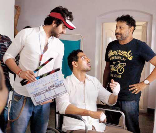 John And Ayushmann Chatting Still On The Sets Of Madras Cafe Movie