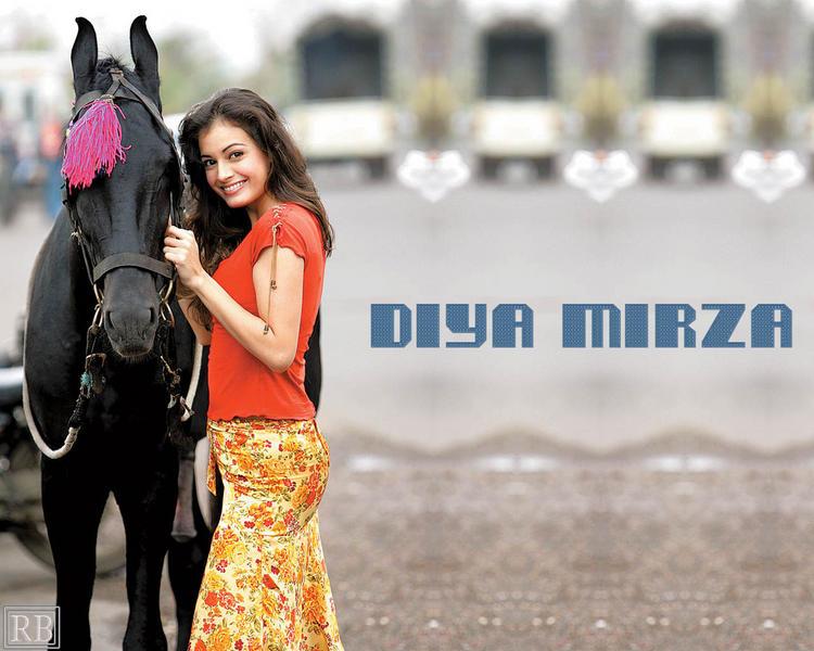 Cute Wallpaper Of Diya Mirza With Horse