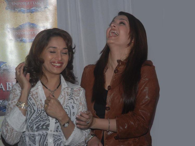 Aishwarya Rai and Madhuri Dixit Gorgeous Smile Pic