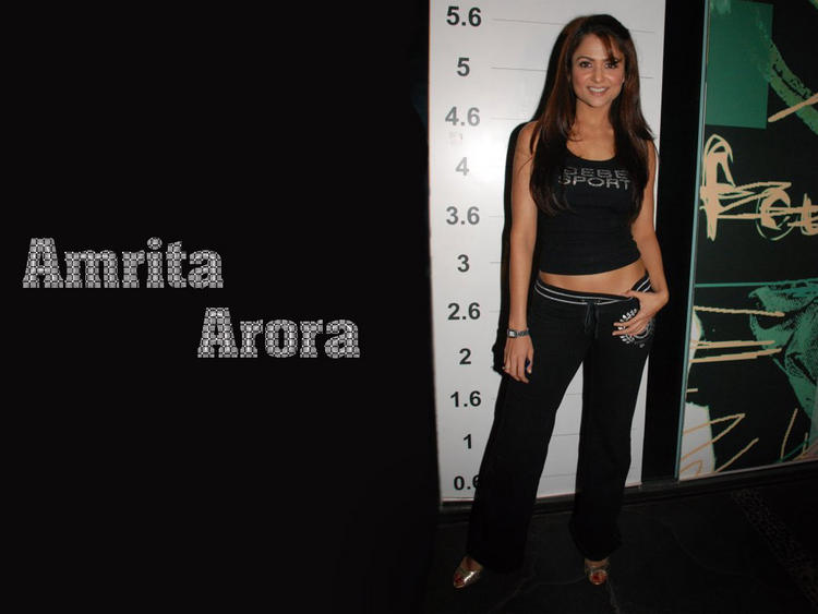 Amrita Arora Standing Poses Wallpaper