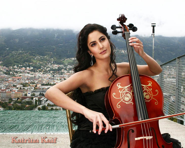 Katrina Kaif Sizzling Wallpaper With Red Violin