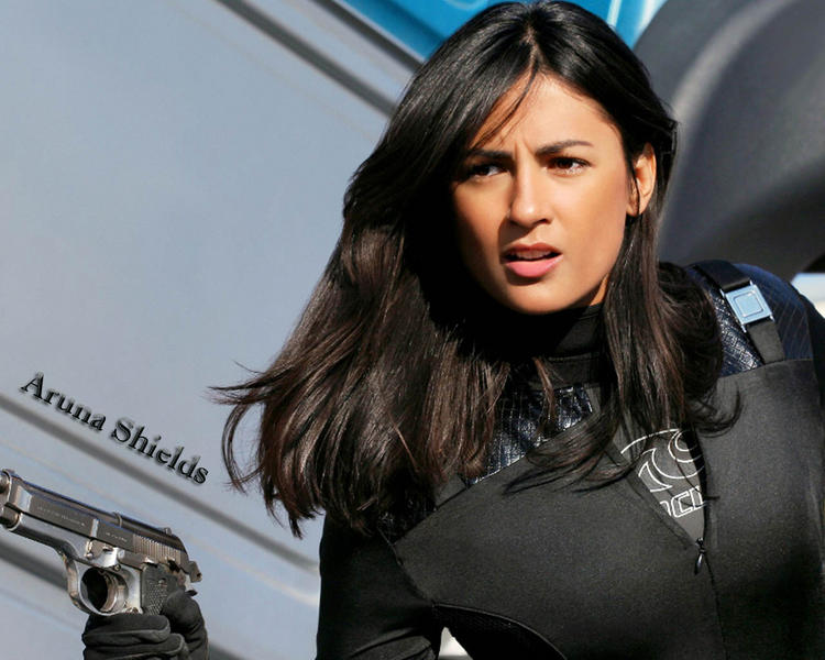 Aruna Shields Hot Still with Gun