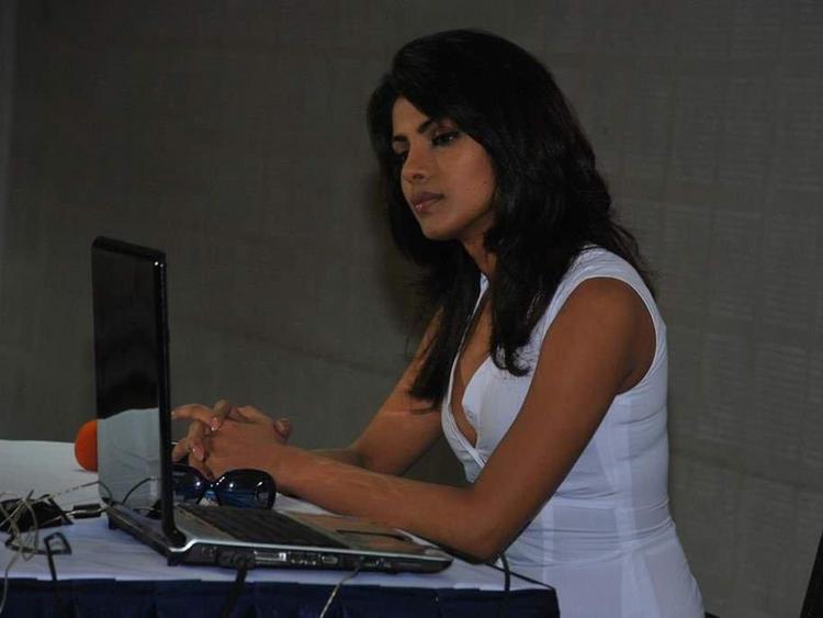 Priyanka Chopra With Laptop Wallpaper