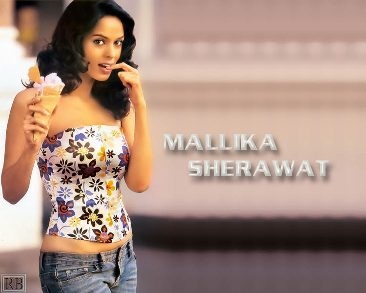 Mallika Sherawat Cute Sexy Wallpaper In Strapless Tops and Jeans