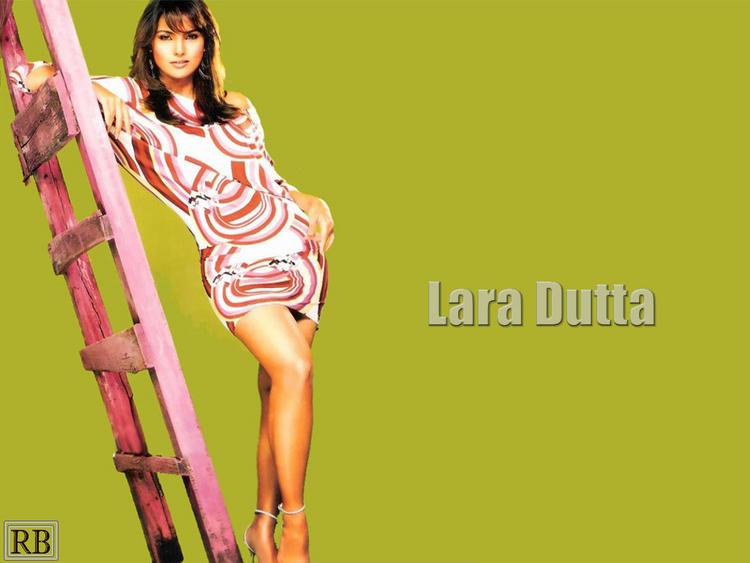 Lara Dutta Glossy Legs Pose Wallpaper
