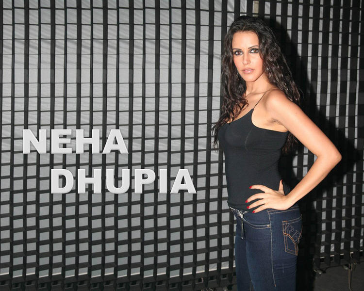 Neha Dhupia Hot Pose In Black Tops and Jeans