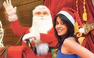Cute Babe Genelia D'Souza Fastens Santa's Red Cap