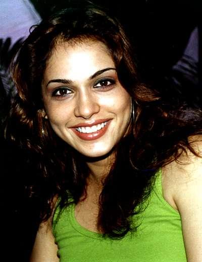 Isha Koppikar Gorgeous Smile Wallpaper