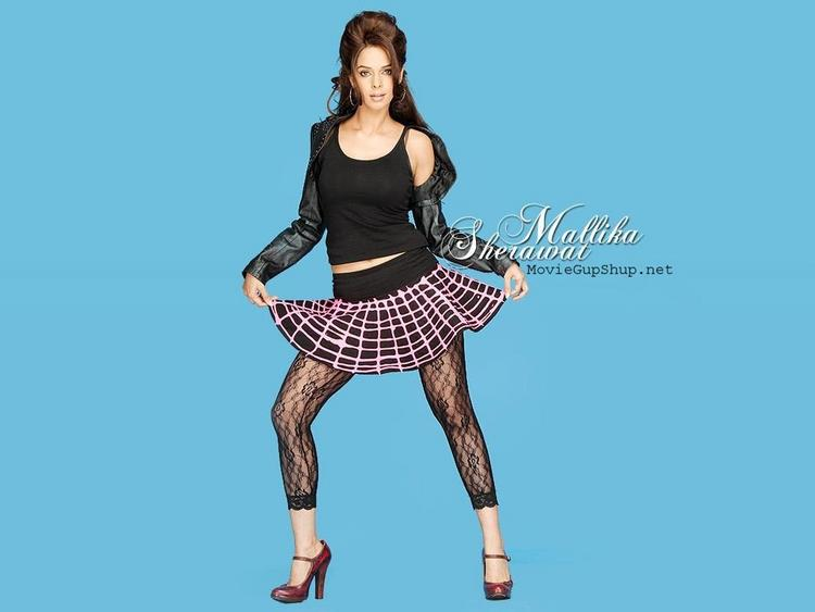 Mallika Sherawat Cute Mini Skirt Showing Wallpaper