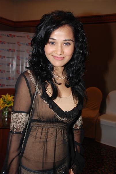 Nisha Kothari Cute Smile Pic In Curly Hair