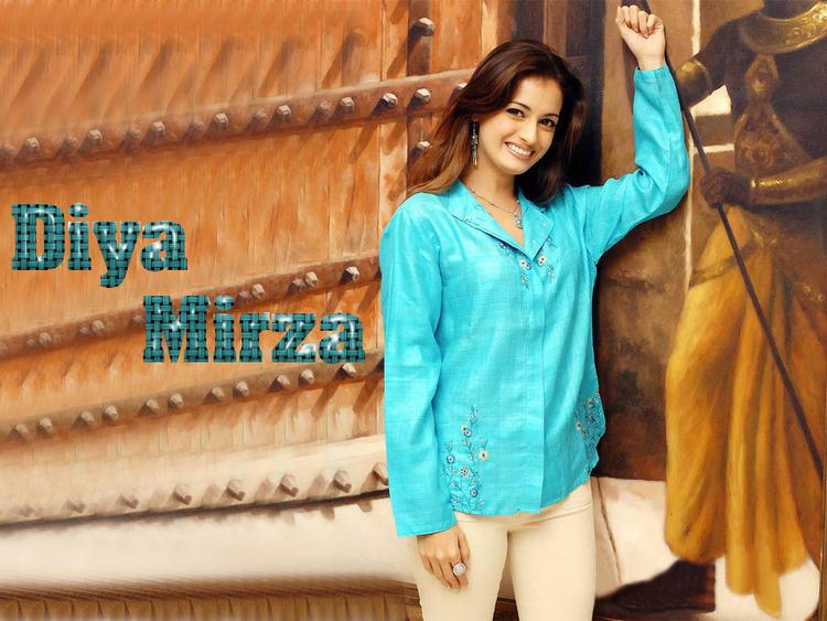 Diya Mirza Sweet Smile Wallpaper With Teal Color Shirt