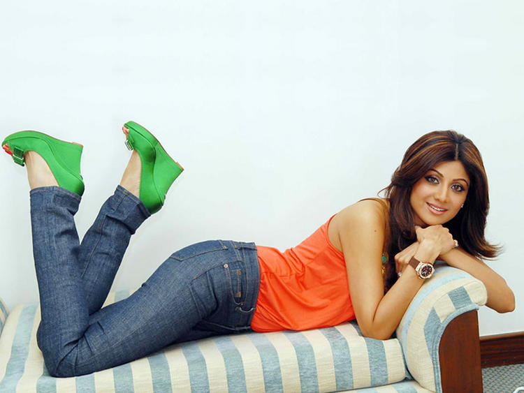 Shilpa Shetty Cute Wallpaper With Orange Tops and Jeans