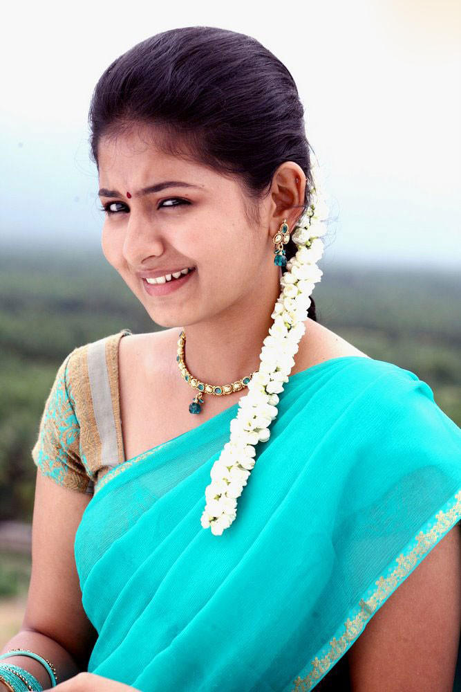 Reshma Menon Teal Color Saree Cute Face Look